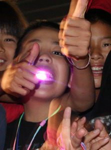 boy with lights in his mouth